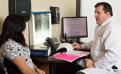 Dr. Hehn with a patient