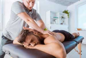 man receiving chiropractic therapy